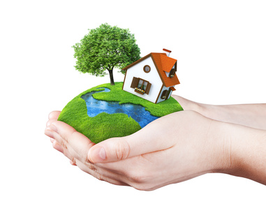 Hands holding house on clear green meadow, tree and river. Concept for growing business, ecology, freshness, freedom and other lifestyle issues. Green fields collection.